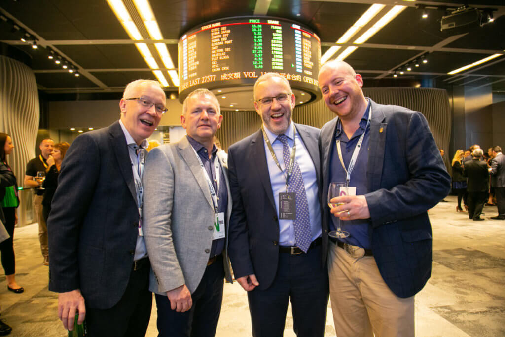 Laurence O'Kane (IMED Healthcare), Paul McKenna (mac-group), Kevin McLoughlin (Lead Partner EY), and Patrick Derry (DRT (NI) Ltd ) at the Hong Kong stock exchange.